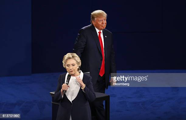 Donald Trump 2016 Republican presidential nominee smiles as Hillary Clinton 2016 Democratic presidential nominee speaks during the second US...