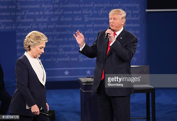 Donald Trump 2016 Republican presidential nominee speaks as Hillary Clinton 2016 Democratic presidential nominee stands during the second US...
