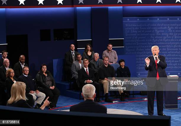 Donald Trump 2016 Republican presidential nominee speaks as moderator Martha Raddatz left gestures during the second US presidential debate at...