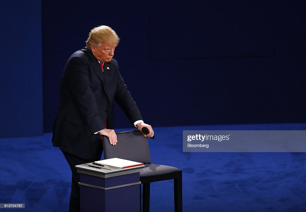 Donald Trump, 2016 Republican presidential nominee, stands during the second U.S. presidential debate at Washington University in St. Louis, Missouri, U.S., on Sunday, Oct. 9, 2016. As has become tradition, the second debate will resemble a town hall meeting, with the candidates free to sit or roam the stage instead of standing behind podiums, while members of the audience -- uncommitted voters, screened by the Gallup Organization -- will ask half the questions. Photographer: Andrew Harrer/Bloomberg via Getty Images