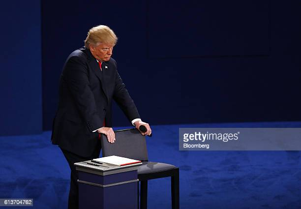 Donald Trump, 2016 Republican presidential nominee, stands during the second U.S. Presidential debate at Washington University in St. Louis,...
