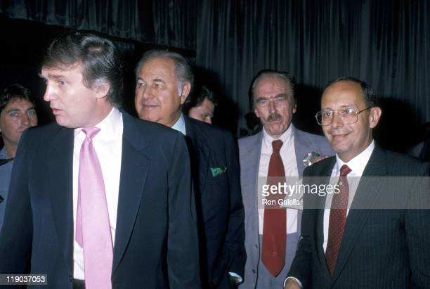 Donald Trump Al Taubman Guest and Al D'amato during Mike Tyson vs Carl Williams July 21 1989 at Trump Plaza in Atlantic City New Jersey United States