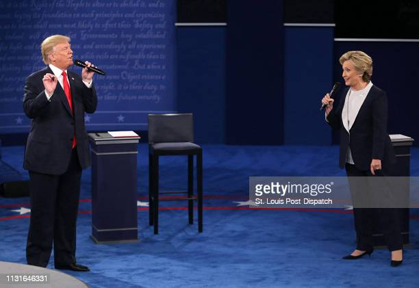 Donald Trump and and Hillary Clinton on stage during the second debate between the Republican and Democratic presidential candidates on October 9 at...