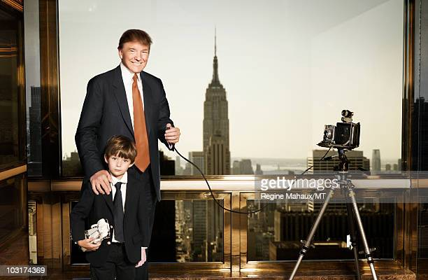Donald Trump and Barron Trump pose for a portrait on April 14, 2010 in New York City. Donald Trump is wearing a suit and tie by Brioni, Barron Trump...