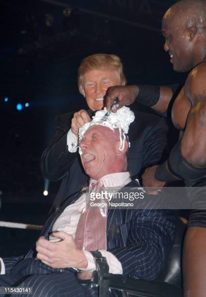 Donald Trump and Bobby Lashley shave Vince McMahon's head after Lashely defeated Umaga in the 'Battle of the Billionaires' match at Ford Field at...