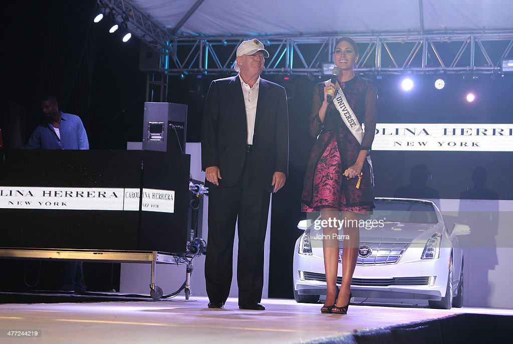 Donald Trump and Gabriela Isler attend the Carolina Herrera Fashion Show with GREY GOOSE Vodka at the Cadillac Championship at Trump National Doral on March 7, 2014 in Doral, Florida.
