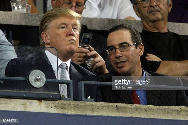 Donald Trump and guest watch the Novak Djokovic of Serbia and Andy Roddick of the United States match during Day 11 of the 2008 US Open at the USTA...