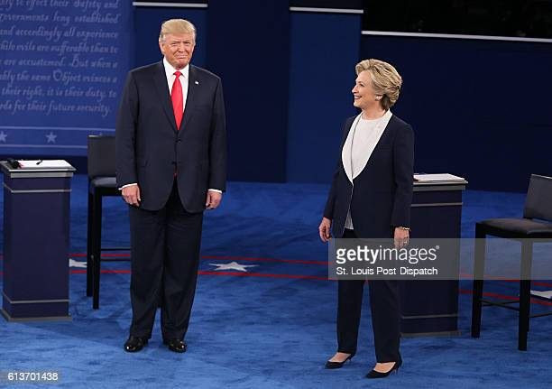 Donald Trump and Hillary Clinton take the stage at the start of the second debate between the Republican and Democratic presidential candidates on...