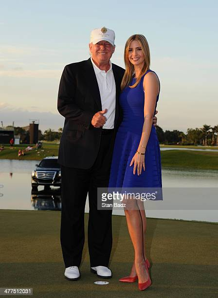 Donald Trump and his daughter Ivanka Trump pose on the 18th green during the final round of the World Golf ChampionshipsCadillac Championship at Blue...