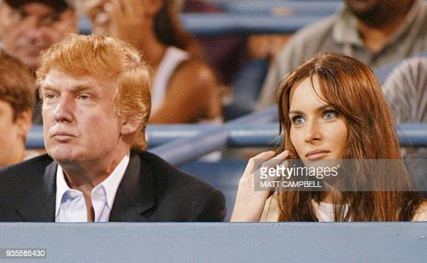 Donald Trump and his girlfriend Melania Knauss watch Andy Roddick of the US play Juan Ignacio Chela of Argentina during their fourth round match at...