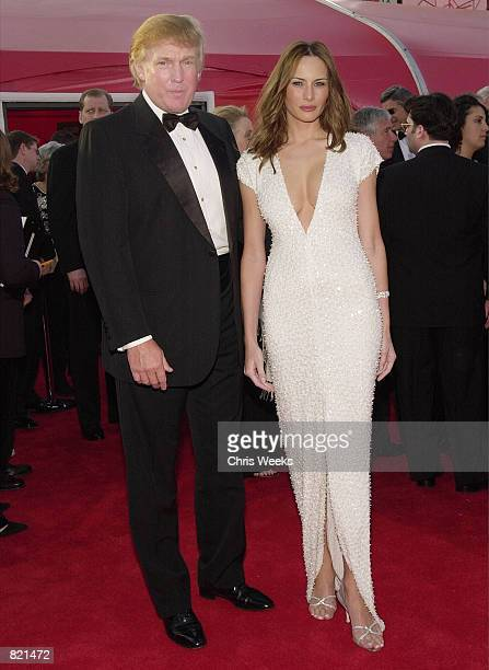 Donald Trump and his girlfriend model Melania Knauss arrive for the 73rd Annual Academy Awards March 25 2001 at the Shrine Auditorium in Los Angeles