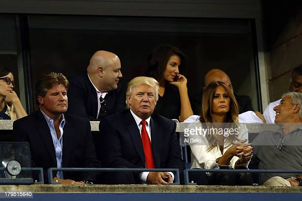 Donald Trump and his wife Melania attend a men's singles quarter final match between Rafael Nadal of Spain and Tommy Robredo of Spain on Day Ten of...
