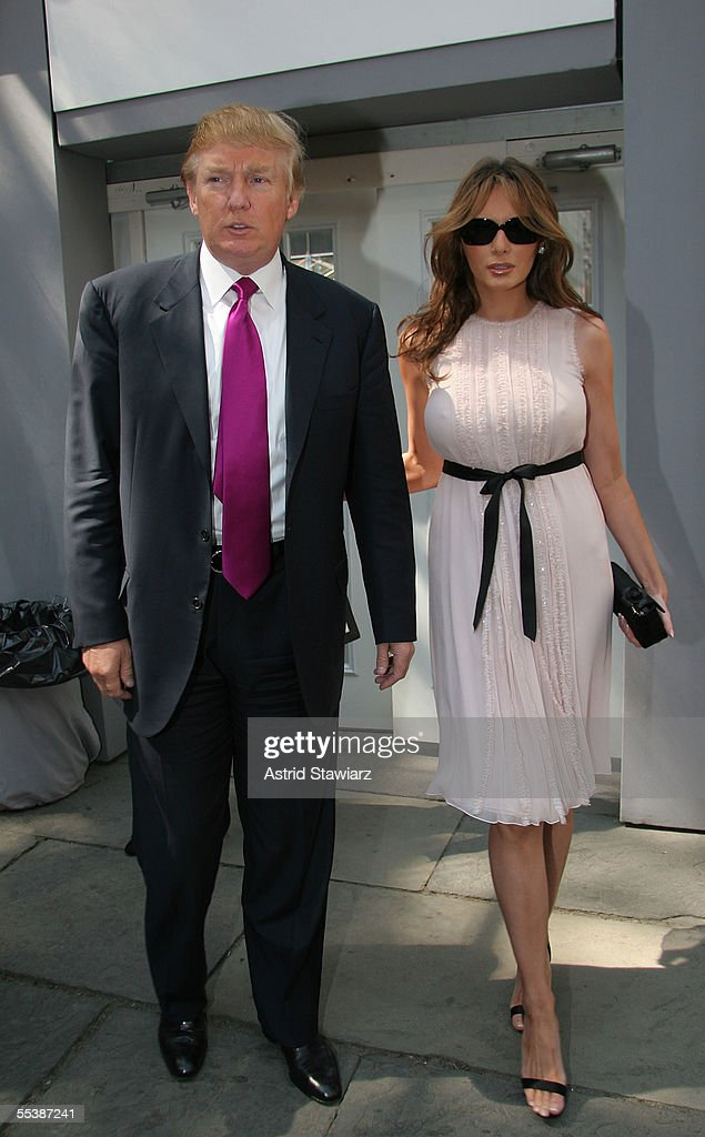 Donald Trump and his wife Melania Trump attends day 4 of Olympus Fashion Week Spring 2006 at Bryant Park September 12, 2005 in New York City.
