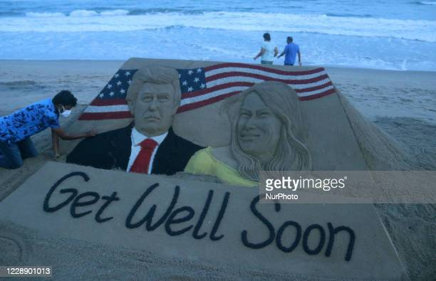 Donald Trump and his wife Melania Trump's sand sculpture is seen with their health recovery message as it is creating by sand artist Sudarshan...