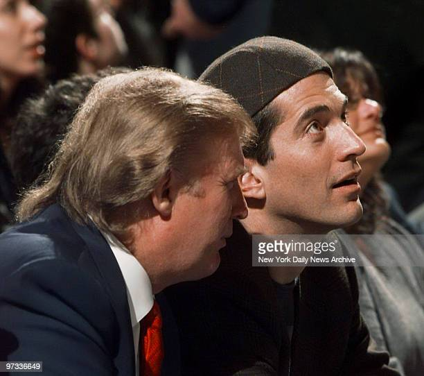Donald Trump and John F Kennedy Jr take in the action as the New York Knicks take on the Indiana Pacers at Madison Square Garden