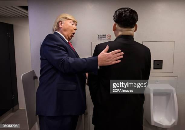Donald Trump and Kim Jongun impersonators jokingly at a toilet