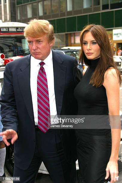Donald Trump and Melania Knauss during MercedesBenz Fashion Week Spring Collections 2003 Celebrities at Bryant Park at Bryant Park in New York City...