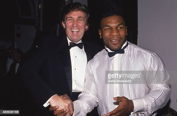 Donald Trump and Mike Tyson attend a March of Dimes dinner in November 1989 in New York City