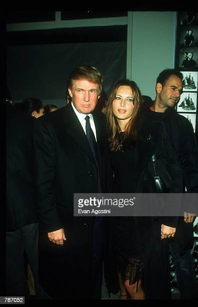 Donald Trump and model Melanie Knaus attends the party for photographer Patrick Demarchelier's latest book Patrick Demarchelier Forms January 28 1999...