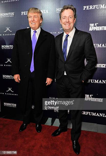 "Donald Trump and Piers Morgan celebrate Perfumania's appearance with Kim Kardashian on ""The Apprentice"" at Provacateur on November 10, 2010 in New..."