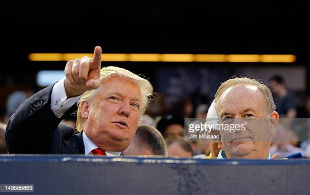 Donald Trump and television personality Bill O'Reilly attend the game between the New York Yankees and the Baltimore Orioles at Yankee Stadium on...