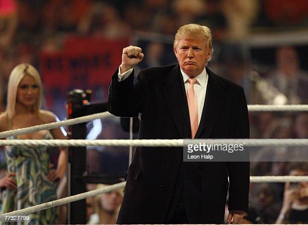"""Donald Trump and Terra Conner former Miss USA in the ring before the start of the main event of the night, """"Hair vs. Hair"""", between Vince McMahon and..."""