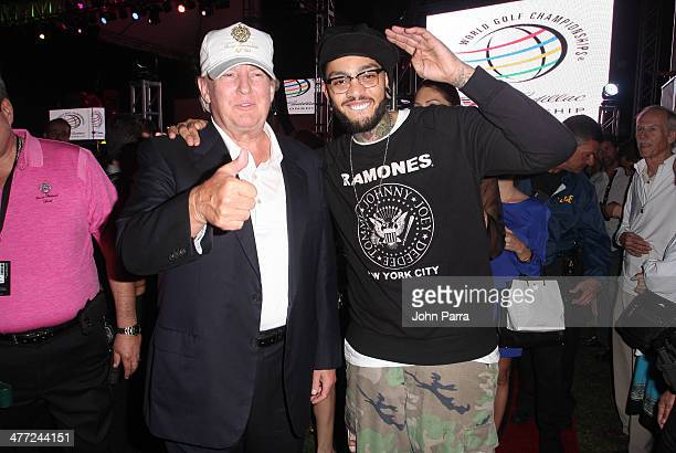 Donald Trump and Travis McCoy attend the Carolina Herrera Fashion Show with GREY GOOSE Vodka at the Cadillac Championship at Trump National Doral on...