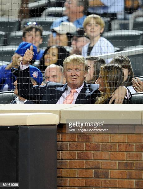 Donald Trump and wife Melania Trump share a kiss during a game between the Los Angeles Dodgers and the New York Mets on July 8 2009 at Citi Field in...