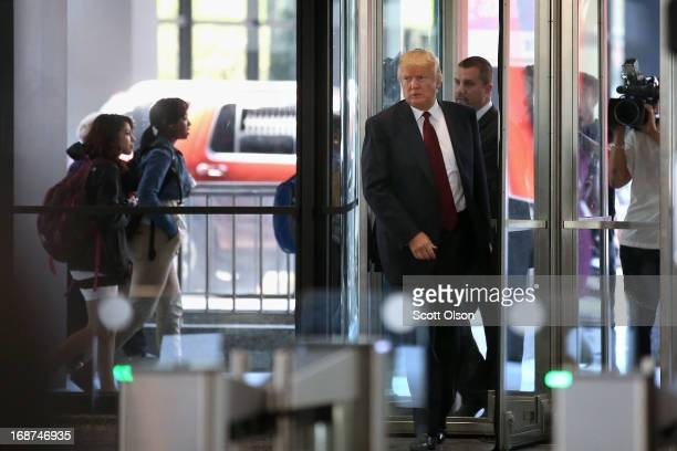 Donald Trump arrives at the Dirksen Federal Courthouse to testify in a civil case involving his Trump Tower on May 14 2013 in Chicago Illinois Jackie...
