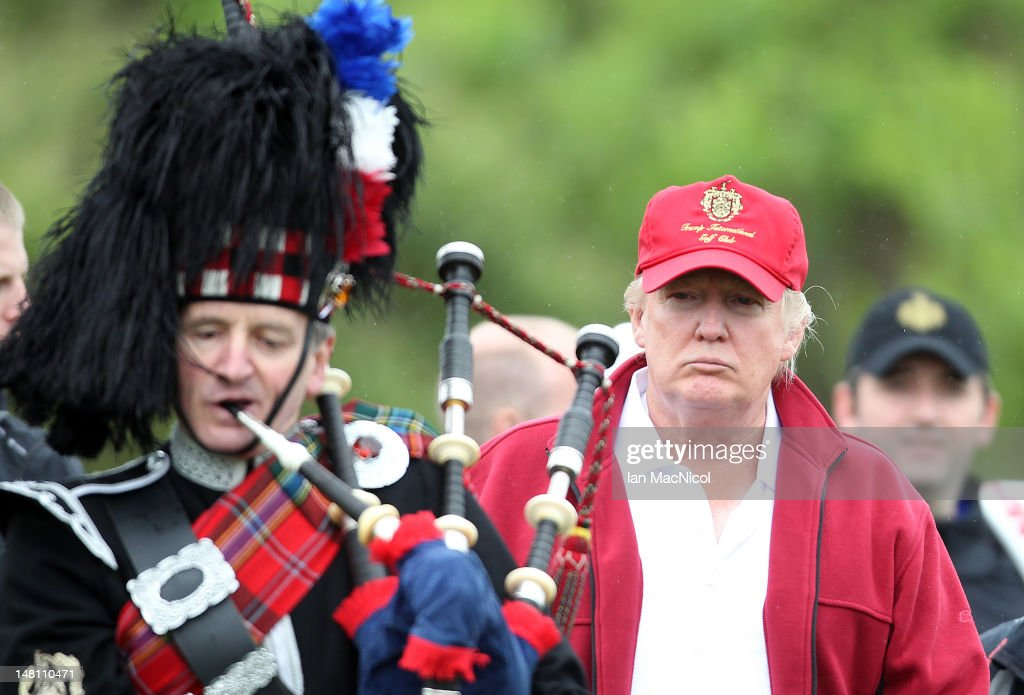 Donald Trump arrives for the opening of The Trump International Golf Links Course on July 10, 2012 in Balmedie, Scotland. The controversial ?100m course opens to the public on Sunday July 15. Further plans to build hotels and homes on the site have been put on hold until a decision has been made on the building of an offshore windfarm nearby.