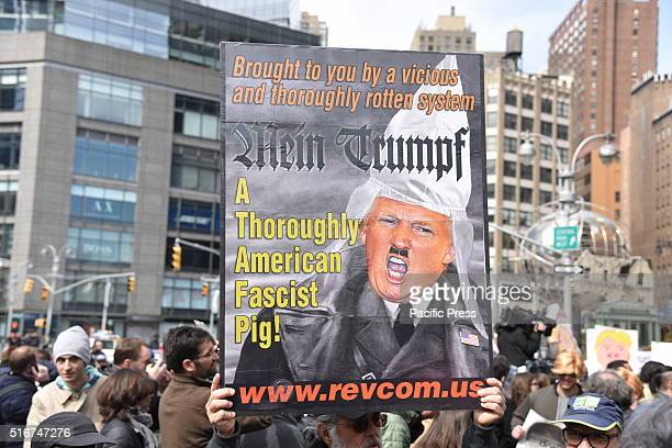 Donald Trump as Adolf Hitler sign at rally in Columbus Circle An estimated one thousand activists gathered to rally at Columbus Circle to oppose the...
