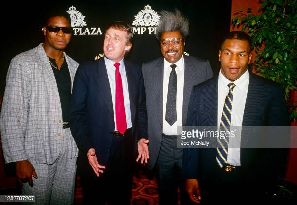 Donald Trump, at the Trump Plaza in Atlantic City, with Don King, boxing promoter, Mike Tyson and unidentified boxer.