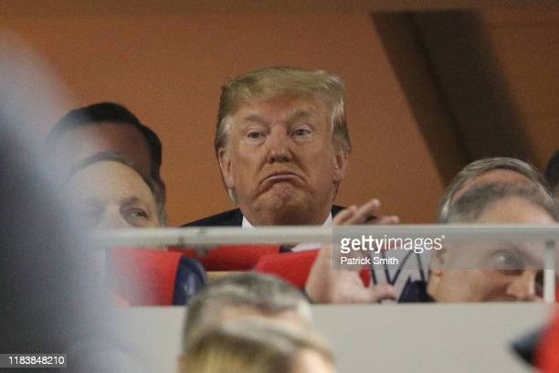 Donald Trump attends Game Five of the 2019 World Series between the Houston Astros and the Washington Nationals at Nationals Park on October 27 2019...