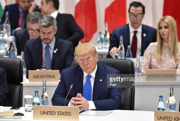 Donald Trump attends the session 3 on women's workforce participation, future of work, and aging societies at the G20 Summit on June 29, 2019 in...