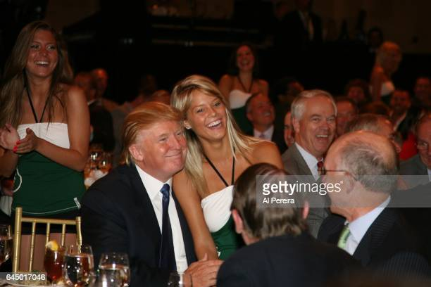 Donald Trump attends with the NY Jets kickoff luncheon party with a member of the New York Jets Flight Crew dance team at Cipriani Wall Street on...