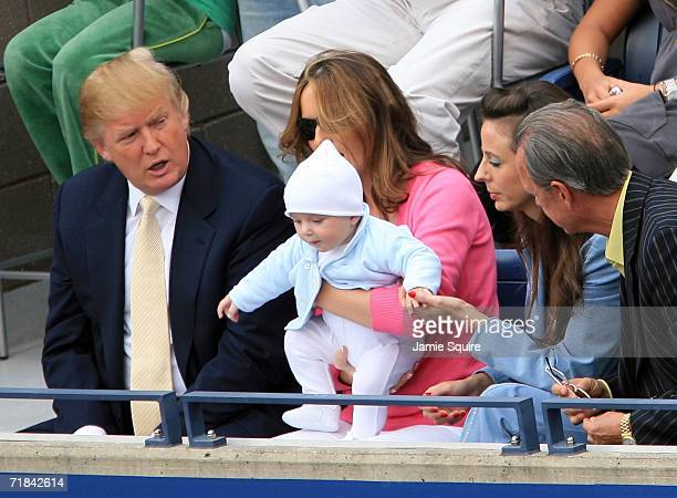 Donald Trump baby son Barron and wife Melania Trump watch the men's final between Roger Federer of Switzerland and Andy Roddick during the US Open at...