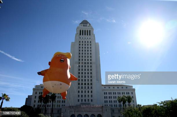 Donald Trump balloon floats in front of Los Angeles City Hall during the Women's March California 2019 on January 19 2019 in Los Angeles California...