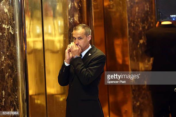 Donald Trump campaign manager Corey Lewandowski speaks on the phone before the Republican presidential candidate makes his way to the podium to speak...