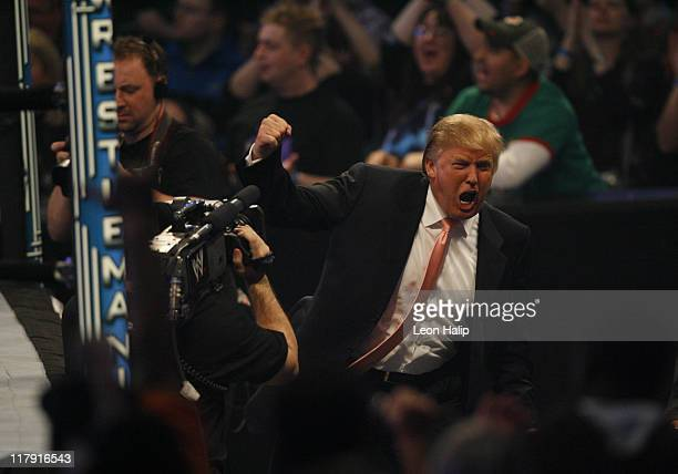 "Donald Trump celebrates his victory over Vince McMahon at the main event of the night, ""Hair vs. Hair"", between Vince McMahon and Donald Trump...."