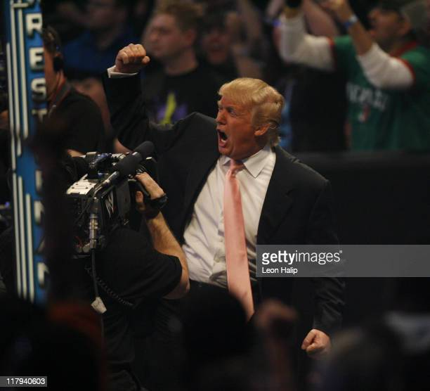 Donald Trump celebrates his victory over Vince McMahon at the main event of the night 'Hair vs Hair' between Vince McMahon and Donald Trump...