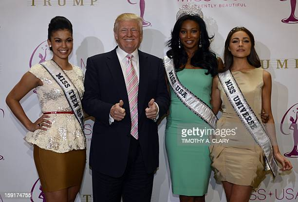 Donald Trump crowns the new Miss USA Nana Meriwether alongside newly appointed Miss Universe Olivia Culpo at the Trump Tower January 9 2013 in New...