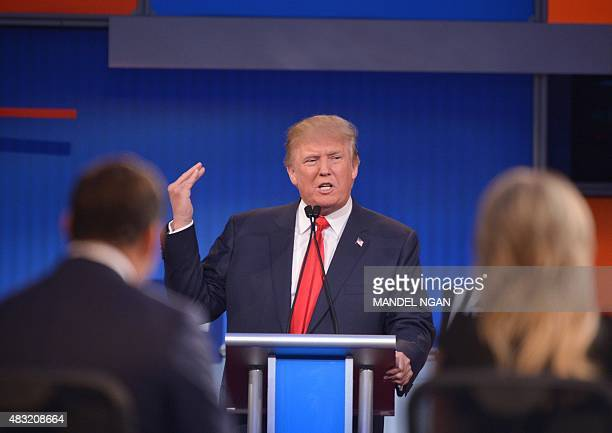 Donald Trump delivers his closing statement during the prime time Republican presidential primary debate on August 6 2015 at the Quicken Loans Arena...