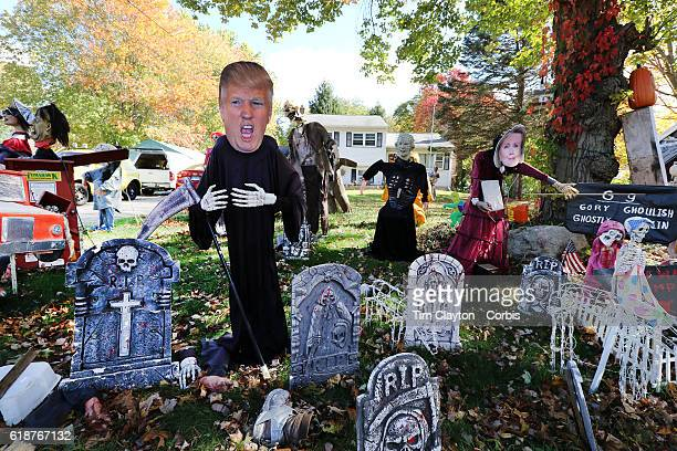 Donald Trump depicted as the Grim Reaper and Hilary Clinton make up a Halloween scene combining the season and the upcoming presidential election in...