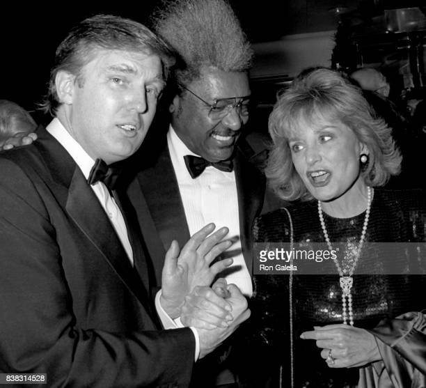 """Donald Trump, Don King and Barbara Walters attend """"The Art of the Deal"""" Book Party on December 12, 1987 at Trump Tower in New York City."""