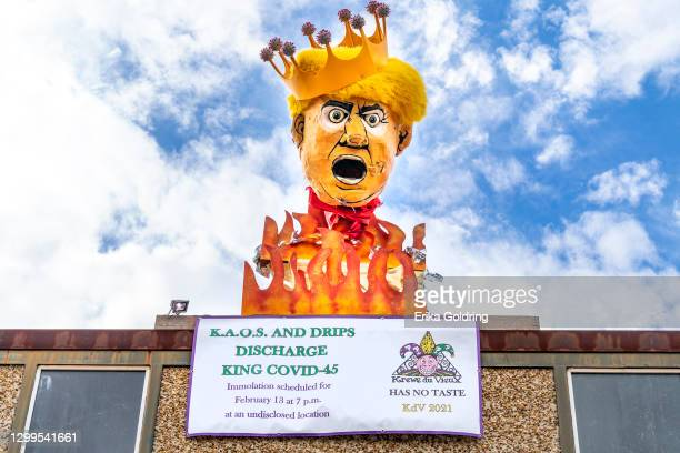 Donald Trump effigy sits on top of a building on January 30, 2021 in New Orleans, Louisiana. Due to the COVID-19 pandemic cancelling traditional...