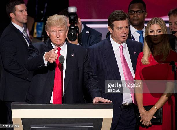 Donald Trump flanked by campaign manager Paul Manafort and daughter Ivanka checks the podium early Thursday afternoon in preparation for accepting...