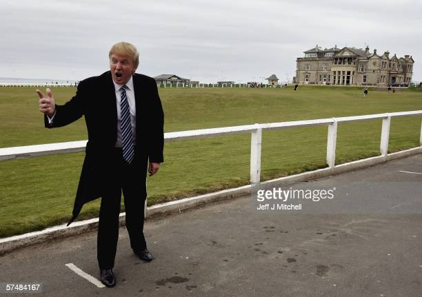 Donald Trump gestures as he arrives at the Old Course in St Andrews where he was meeting with the media to answer questions regarding Trump...