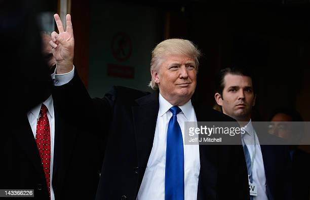 Donald Trump gives the victory salute to members of public following his address to the Scottish Parliament on April 25 20012 in Edinburgh United...