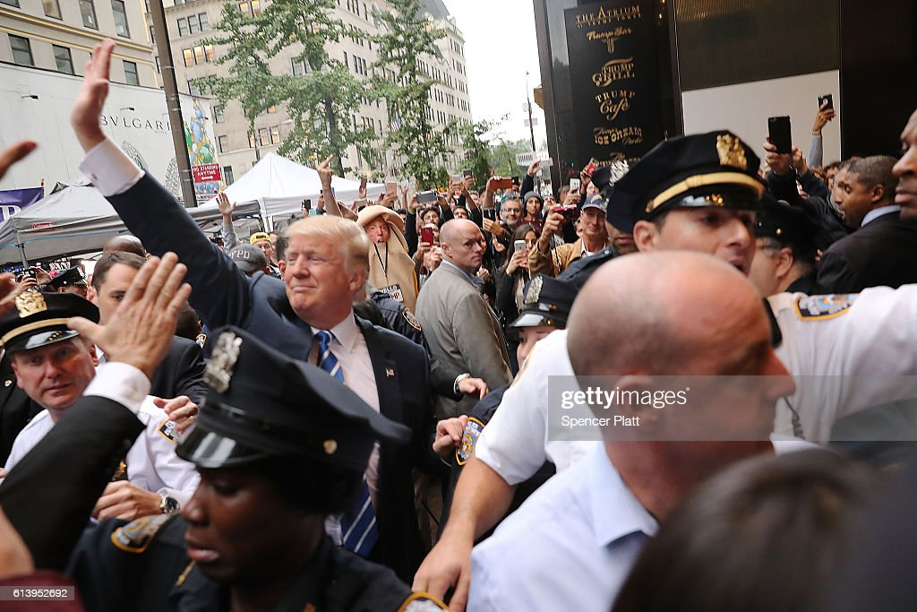 Donald Trump greets supporters outside of Trump Tower in Manhattan October 8, 2016 in New York City. The Donald Trump campaign has faced numerous calls for him to step aside after a recording from 2005 revealed lewd comments Trump made about women.