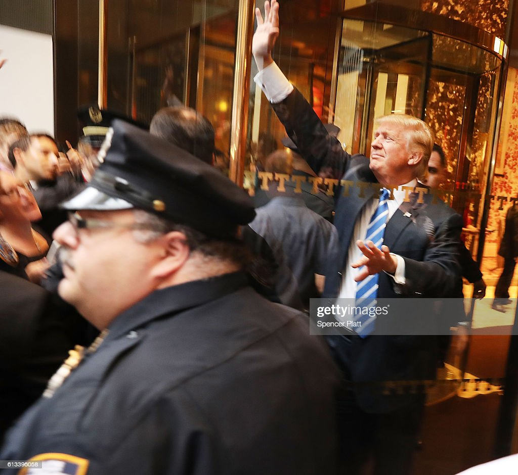 Donald Trump greets supporters outside of Trump Towers in Manhattan October 8, 2016 in New York City. The Donald Trump campaign has faced numerous calls for him to step aside after a recording from 2005 revealed lewd comments Trump made about women.